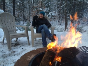 My sister-in-law warming up by the campfire:)