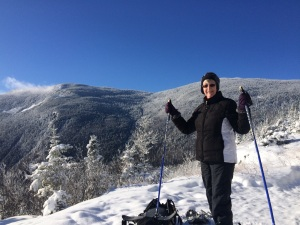 My mom at the top of Mount Willard in her new snow shoes!  Quite the view up there.