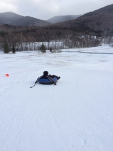 Huck Finn flying down the snowy hill!